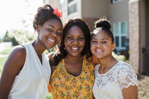 New homeowner Anika Williams and daughters